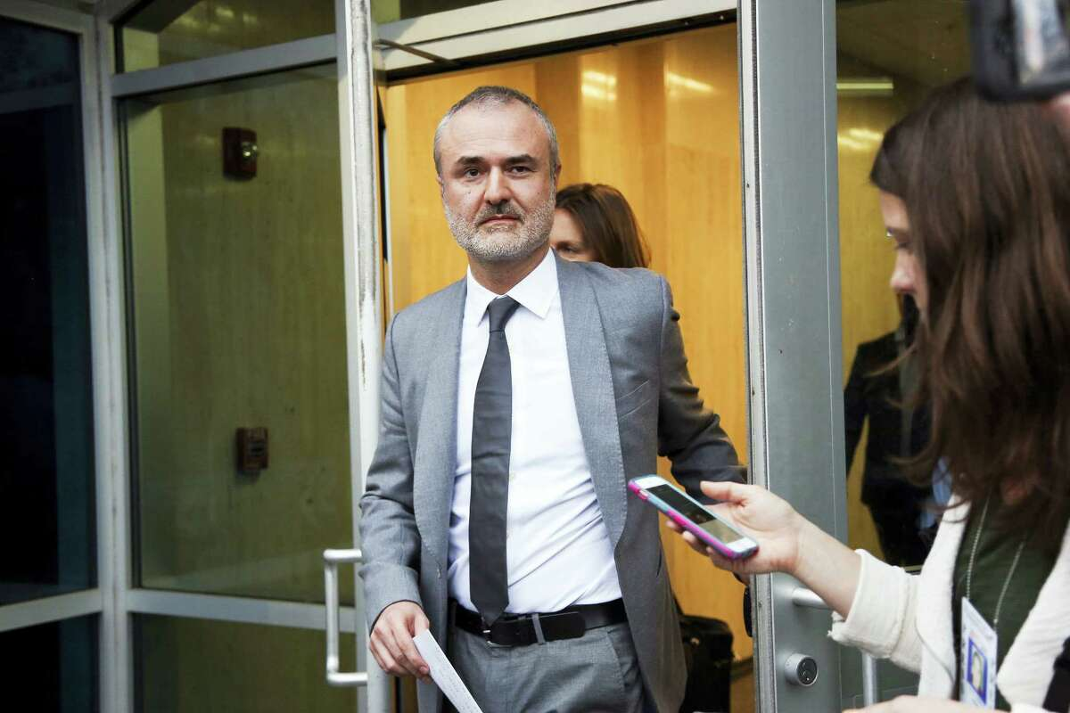 Gawker founder Nick Denton walks out of the courthouse in St. Petersburg, Fla. in March. Gawker.com is going to shut down as its parent company is sold to Univision, a reporter for the 14-year-old site said Thursday, Aug. 18, 2016. A Gawker report said that Denton told staffers that Gawker.com was ending on Thursday afternoon.
