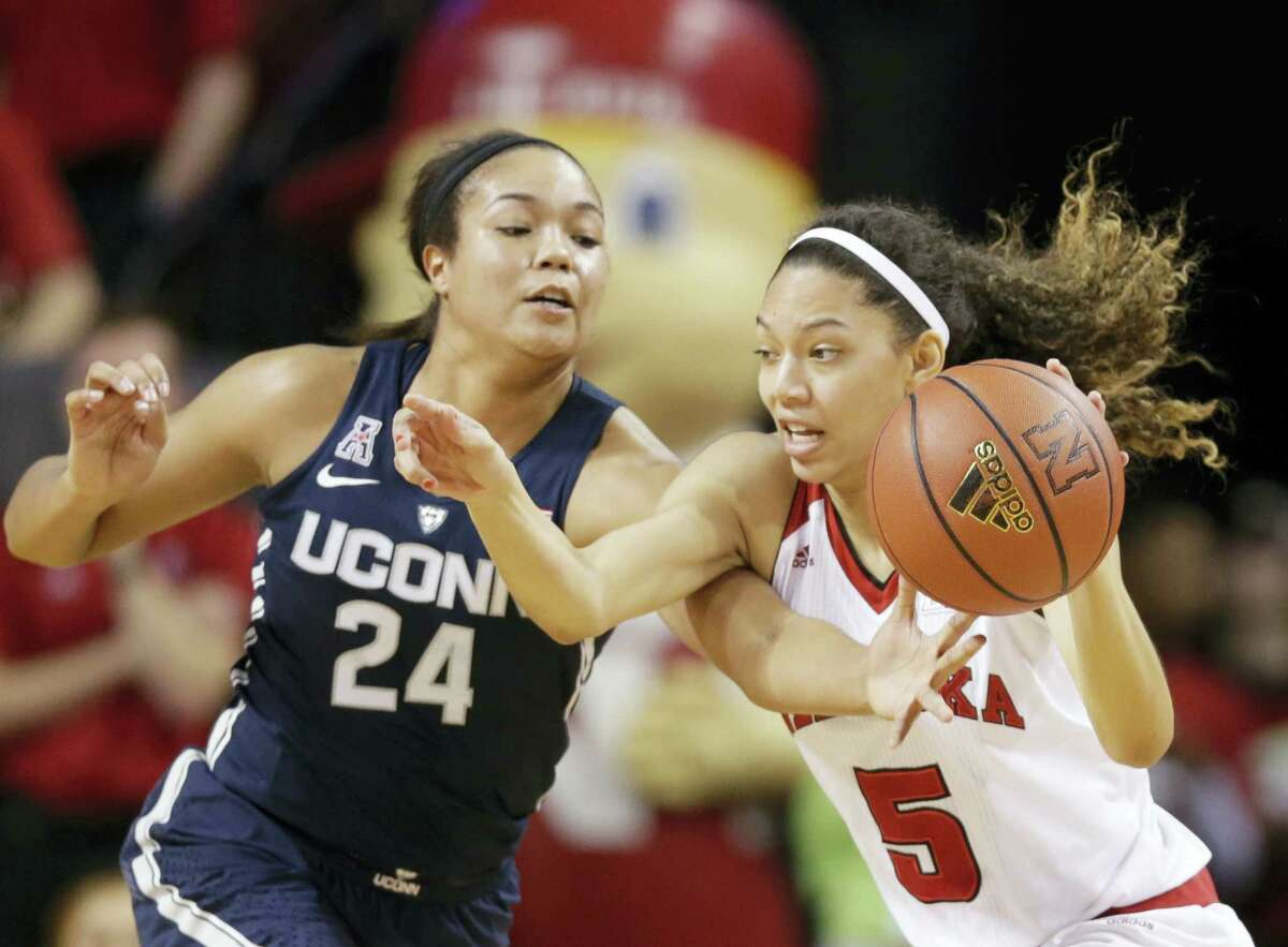 Nebraska's Nicea Eliely (5) is defended by UConn's Napheesa Collier (24) during the first half of action Wednesday.