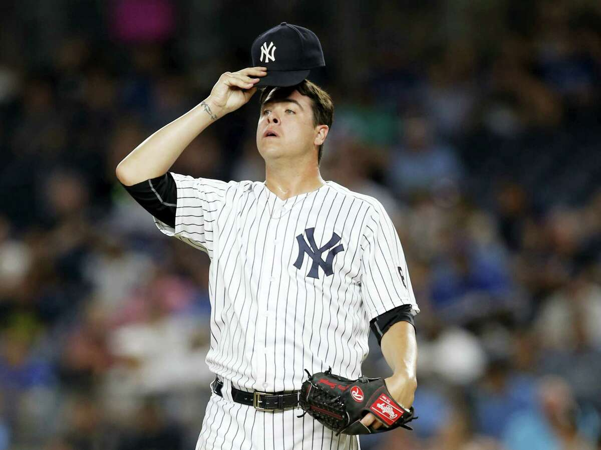 New York Yankees relief pitcher Anthony Swarzak reacts in the sixth inning against the Toronto Blue Jays in New York, Tuesday. The Blue Jays rallied for a 12-6 victory.