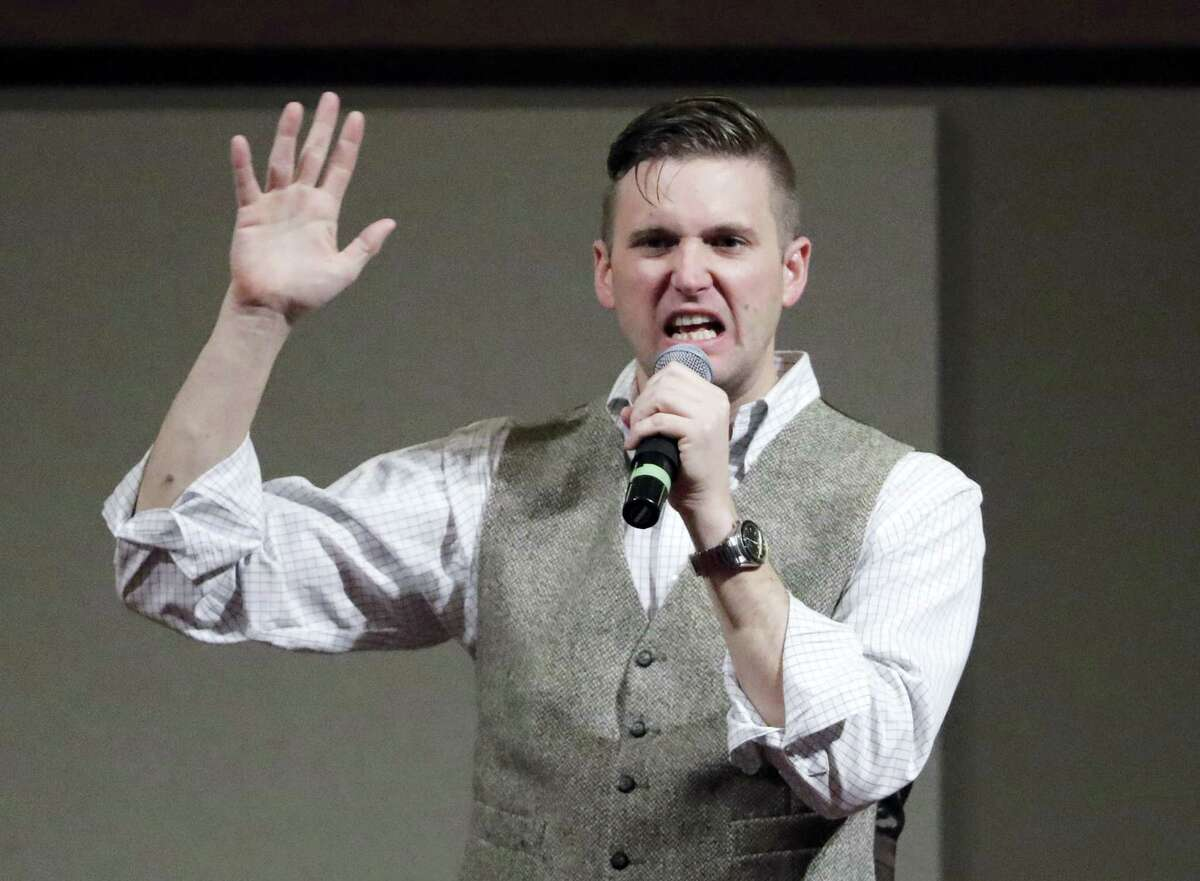 """In this Dec. 6, 2016 photo, Richard Spencer, who leads a movement that mixes racism, white nationalism and populism, speaks at the Texas A&M University campus in College Station, Texas. The Montana-based National Policy Institute, run by Spencer, who popularized the term """"alternative right,"""" is among groups of the white nationalist movement with tax-exempt status."""