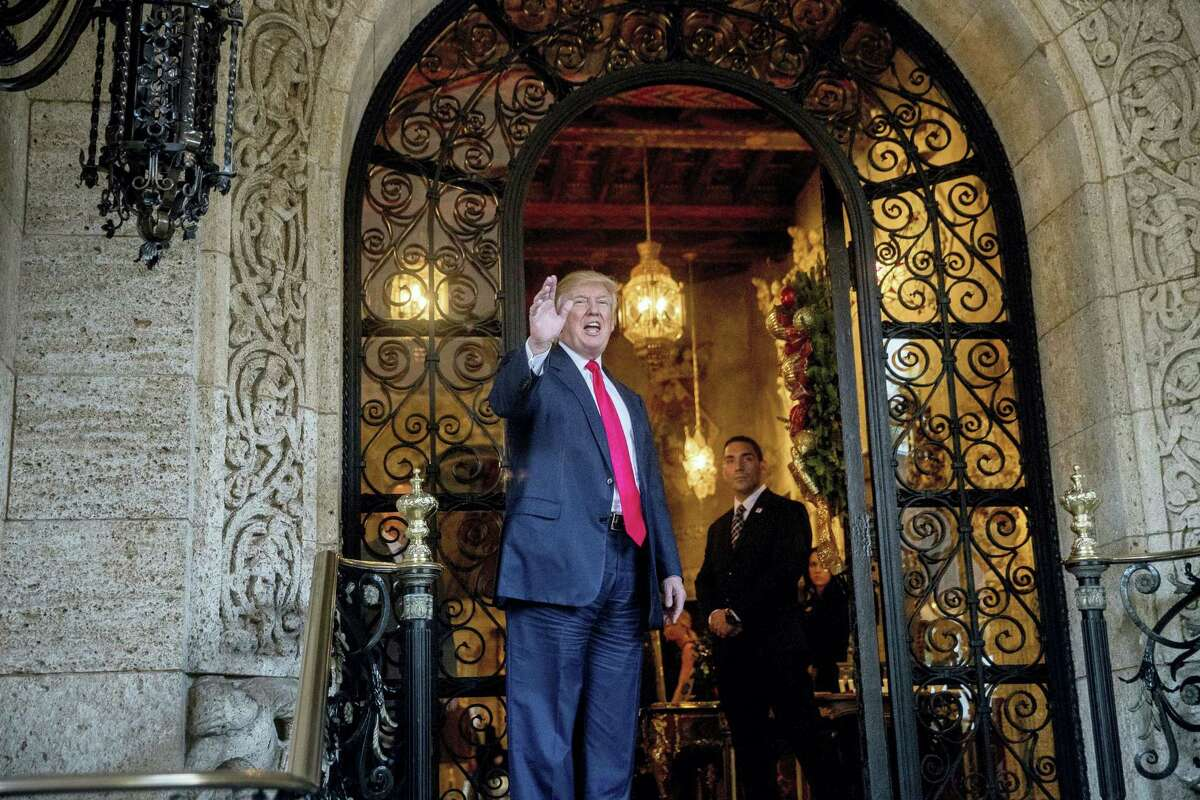 President-elect Donald Trump waves to members of the media after a meeting with admirals and generals from the Pentagon at Mar-a-Lago, in Palm Beach, Fla. on Wednesday, Dec. 21, 2016.
