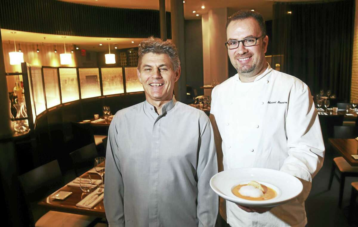Olea manager Juan Gonzalez, left, is photographed with executive chef and co-owner Manuel Romero holding a bowl of gazpacho at their restaurant on High Street in New Haven.