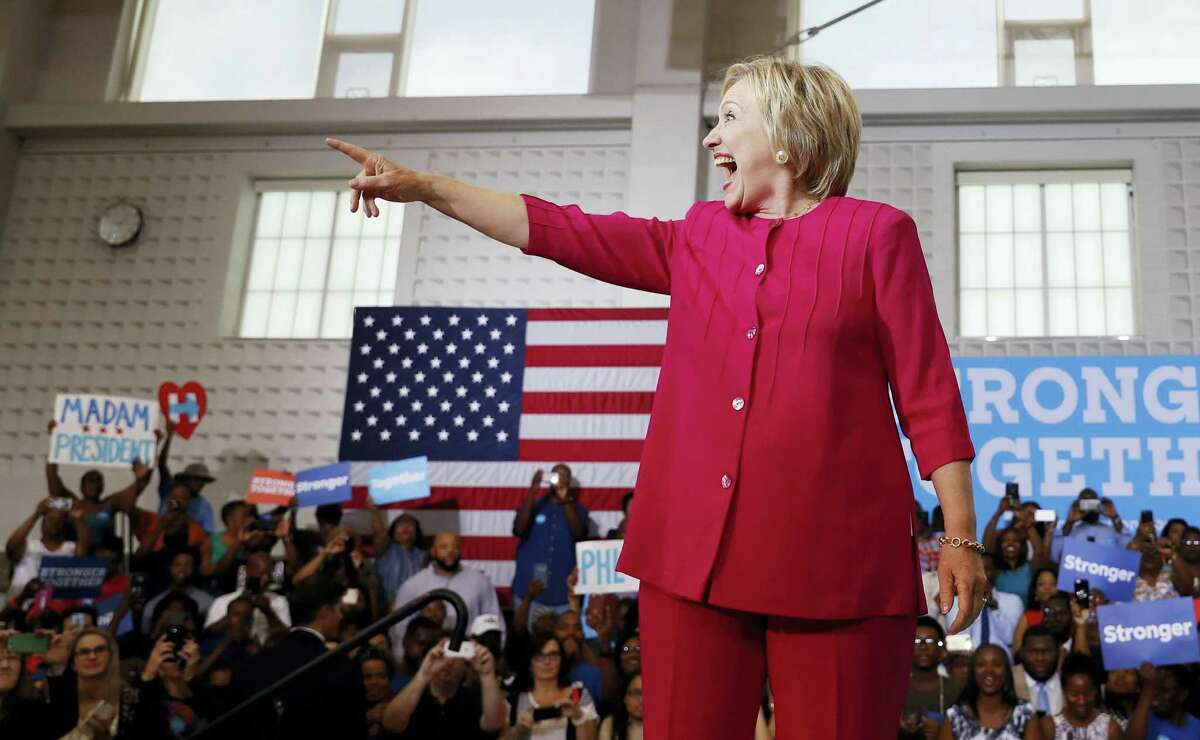 Democratic presidential candidate Hillary Clinton reacts to the cheering crowd as she arrives at a Pennsylvania Democratic Party voter registration event at West Philadelphia High School in Philadelphia on Aug. 16, 2016.