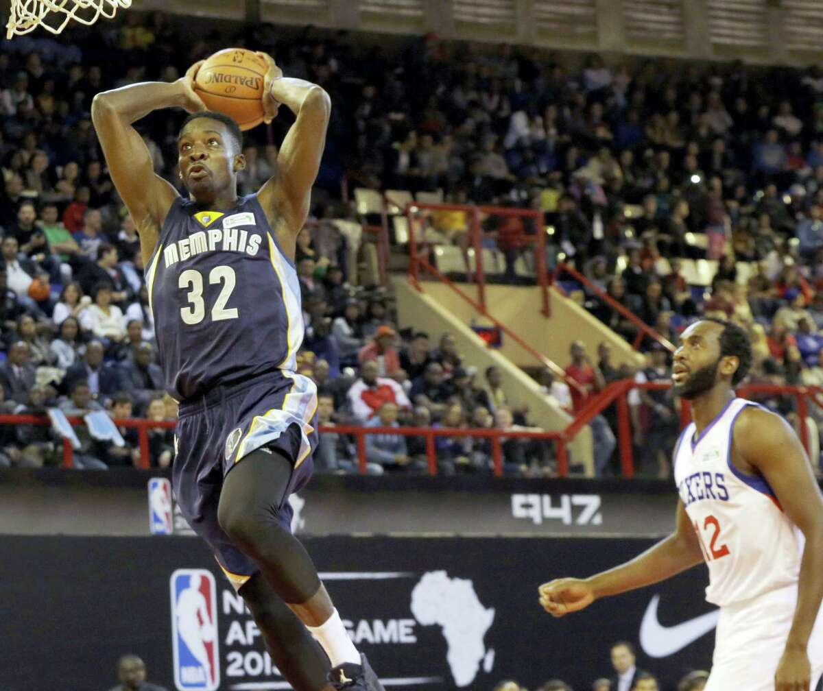 In this Aug. 1, 2015 photo, Team World's Jeff Green of Memphis Grizzlies, left, goes up for a shot as Team Africa's Luc Mbah a Moute from Cameroon looks on during the NBA Africa Game at Ellis Park Arena in Johannesburg, South Africa. The NBA will open an academy in Africa in 2017, its latest move to unearth talent from outside the United States and extend the league's reach into new territories.