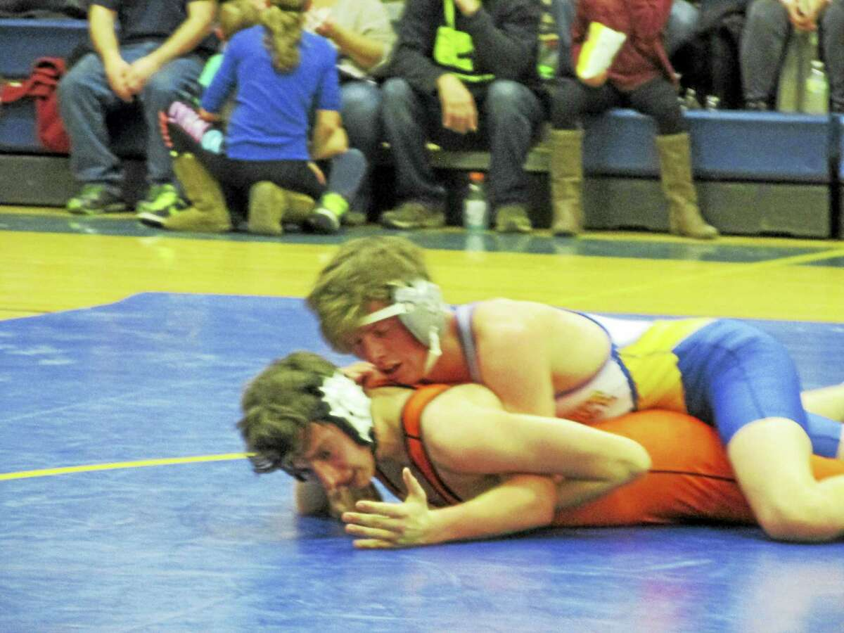 Gilbert's Ben Mow (top) and Kangaroo Jake Cotton fought to a 5-2 decision by Mow in Terryville's win at The Gilbert School Wednesday evening.