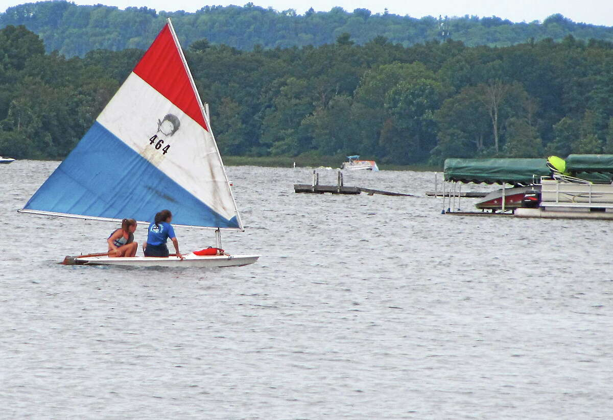 File photo - The Register Citizen Sailors take a small boat out on Bantam Lake during the inaugural Bantam Lake Day celebration in Morris in 2014. In spite of health concerns, the annual lake day will be held Saturday, but no swimming will be allowed.