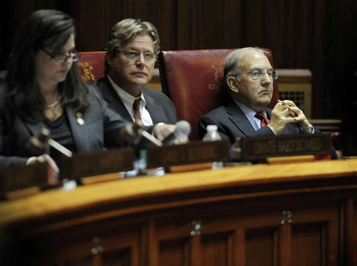 Senate President Martin Looney, right, listens in the Senate during a special session on a plan to close a projected $350 million budget deficit in the current fiscal year, at the state Capitol, Tuesday, Dec. 8, 2015, in Hartford, Conn.