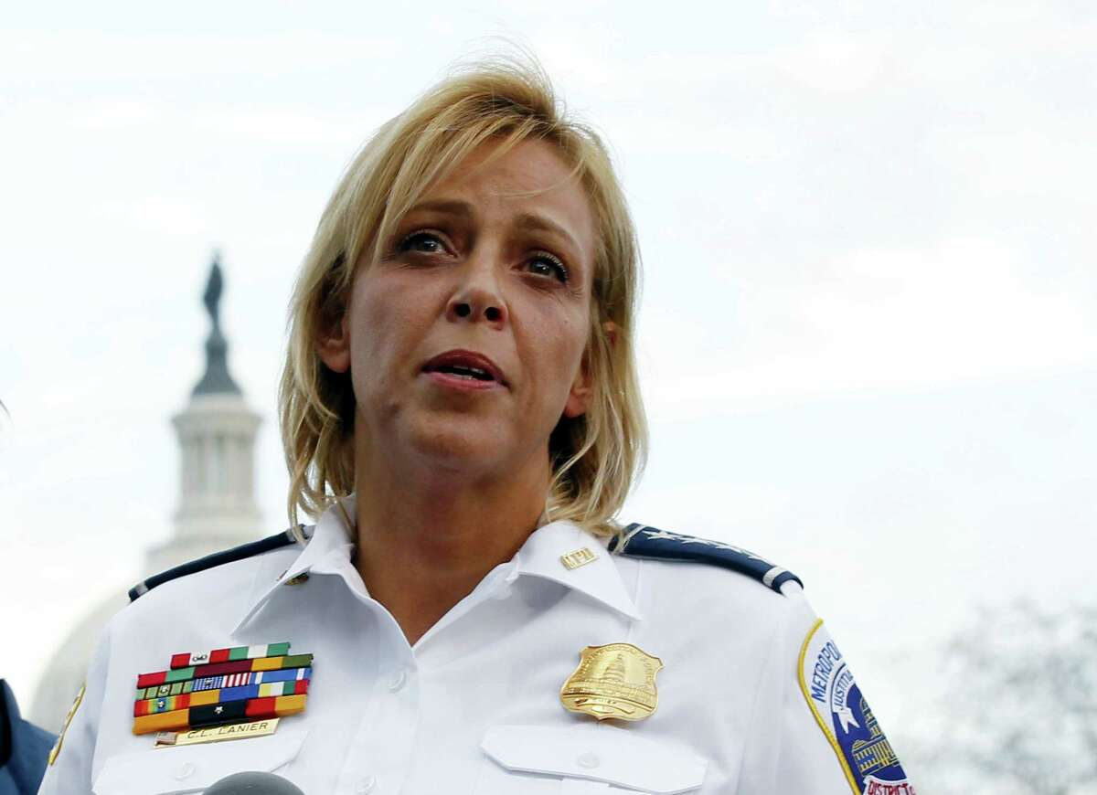 In this Oct. 3, 2013 photo, Washington Police Chief Cathy Lanier speaks on Capitol Hill in Washington. Lanier is stepping down to become head of security for the National Football League.