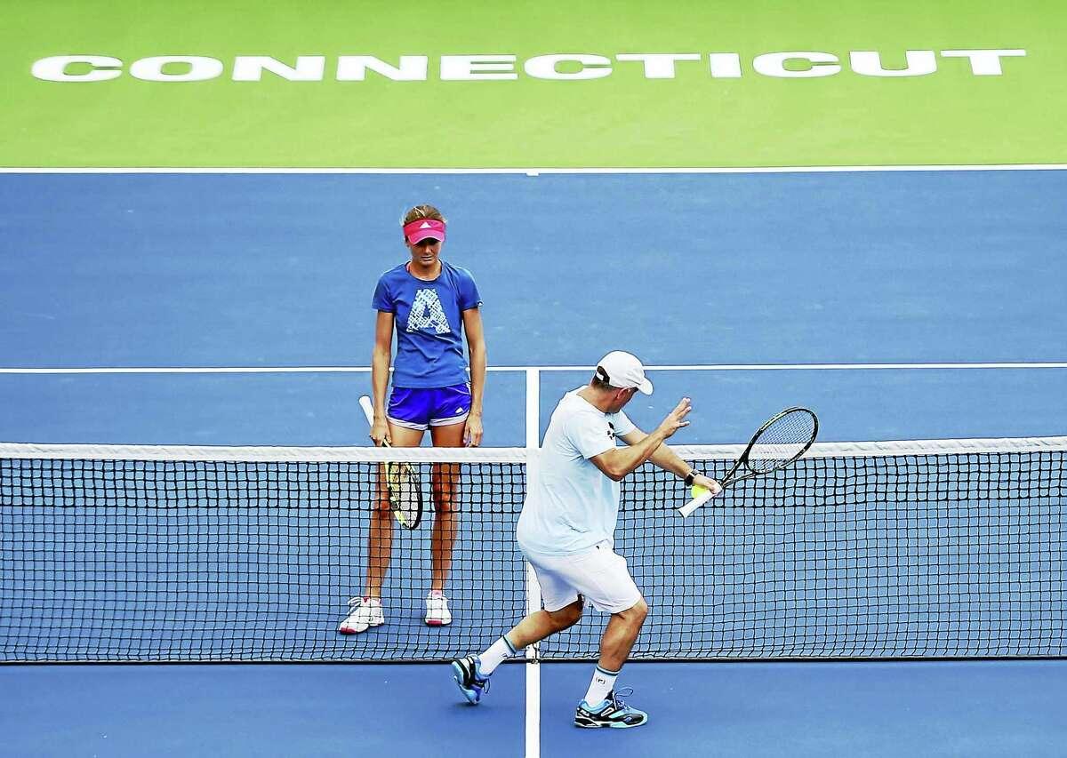 Tennis player Daniela Hantuchova of Slovakia, left, works out with her coach Eduardo Nicolas on Stadium Court Tuesday.