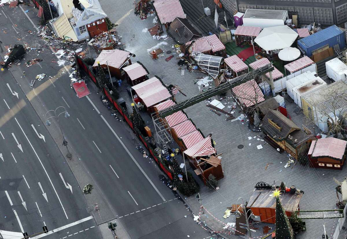 Debris still lies on the crime scene in Berlin, Germany, Wednesday, Dec. 21, 2016, two days after a truck ran into a crowded Christmas market and killed several people.