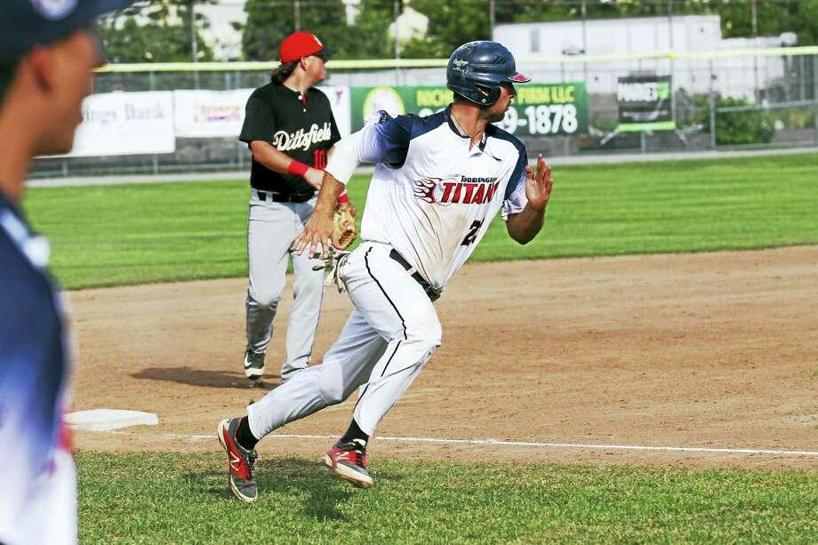 File photo - The Register Citizen A Titans player races toward a base during a game last season. Photo: Journal Register Co. / 2015