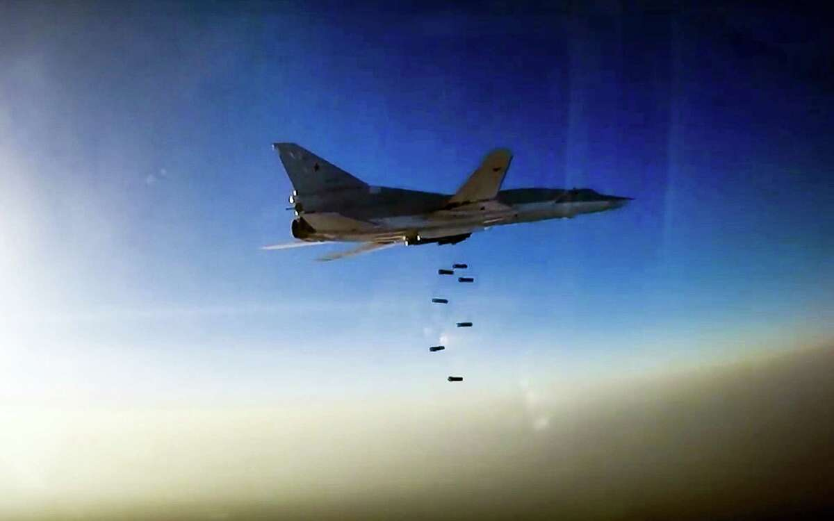 In this frame grab provided by Russian Defence Ministry press service, Russian long range bomber Tu-22M3 flies during an air strike over Aleppo region of Syria on Aug. 16, 2016. Russia's Defense Ministry said on Tuesday Russian warplanes have taken off from a base in Iran to target Islamic State fighters in Syria.