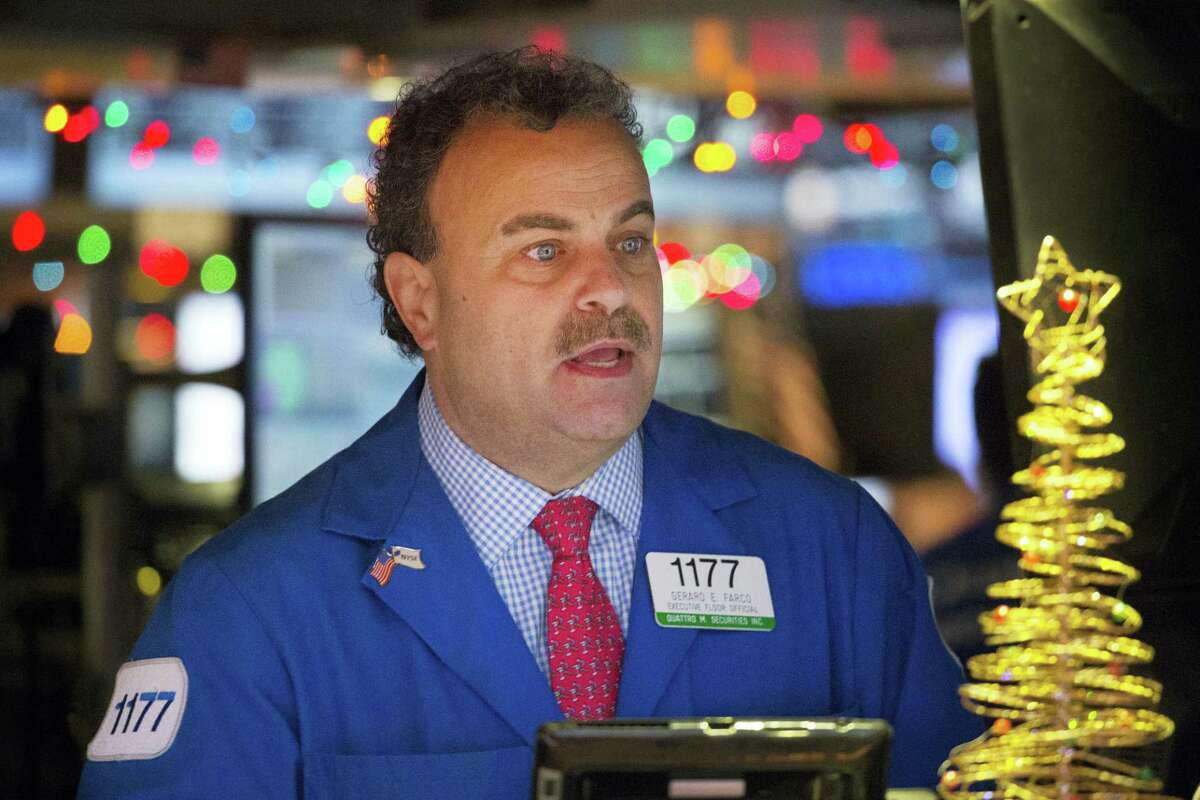 Gerard Farco follows stock prices at the New York Stock Exchange Wednesday in New York.