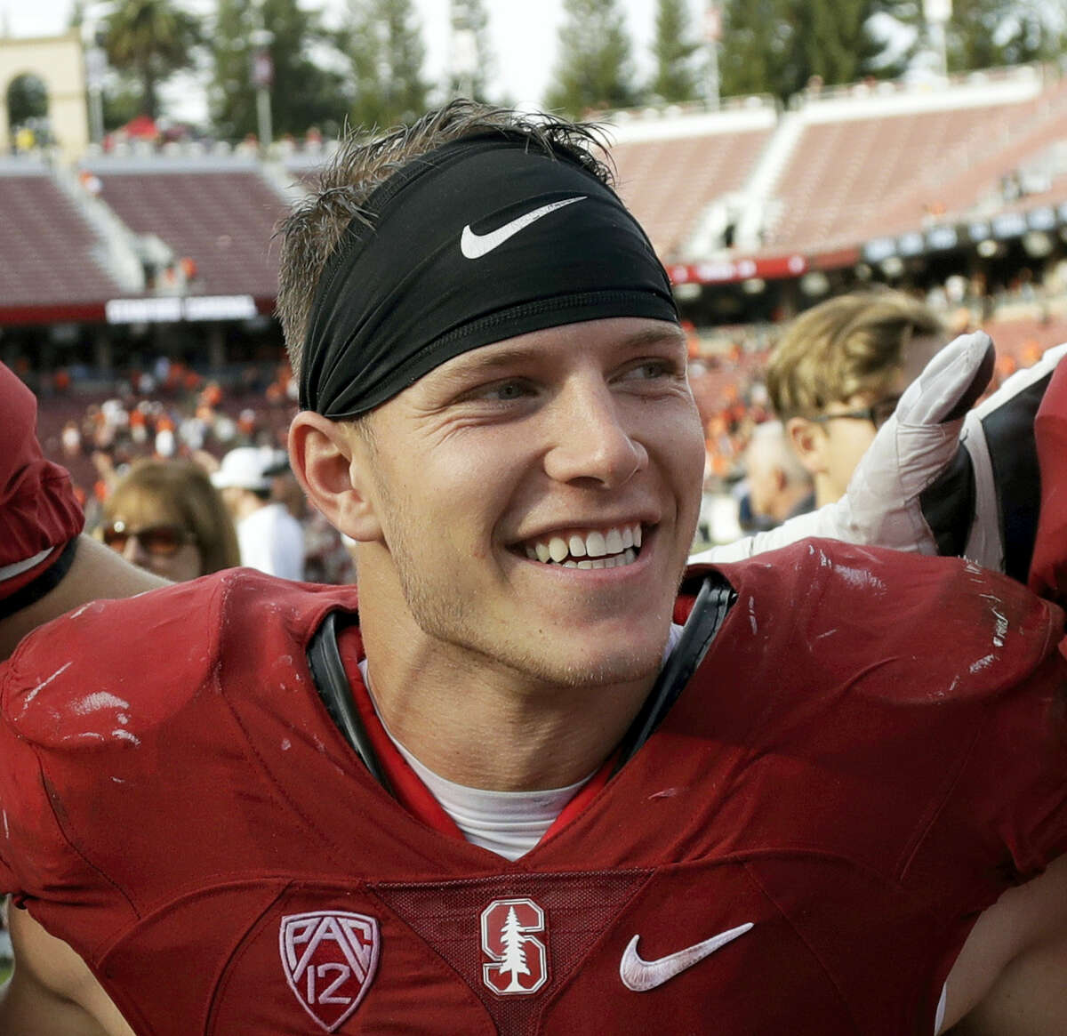 In this Nov. 5 file photo, Stanford running back Christian McCaffrey smiles after Stanford defeated Oregon State 26-15. McCaffrey is done playing college football. Stanford's star running back announced on Twitter on Monday, Dec. 19, 2016, that he will not play in the Sun Bowl game against North Carolina on Dec. 30 in El Paso, Texas.