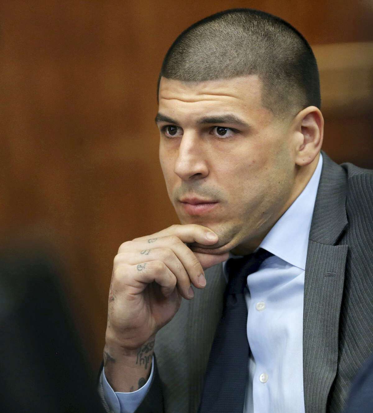 Former New England Patriots NFL football player Aaron Hernandez appears during a hearing at Suffolk Superior Court, Tuesday, Dec., 20, 2016.