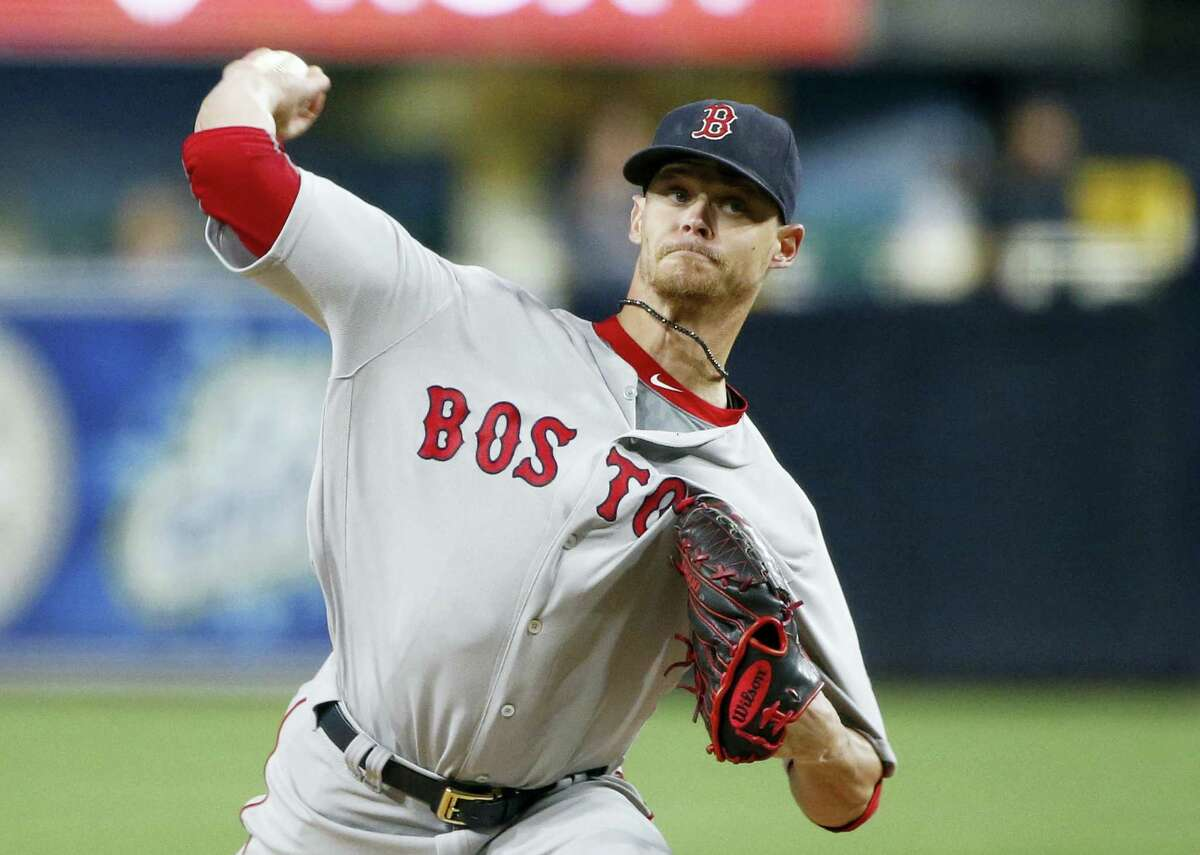 In this file photo, Boston Red Sox starting pitcher Clay Buchholz works against the San Diego Padres. The Red Sox have traded right-hander Clay Buchholz to the Philadelphia Phillies for minor league second baseman Josh Tobias, Tuesday.