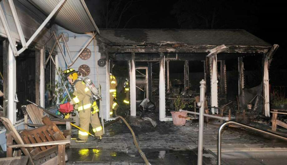 A fire heavily damaged a home at 3 Coves End Lane on Candlewood Isle in New Fairfield late Sunday night, June 20, 2010. Photo: Carol Kaliff / The News-Times