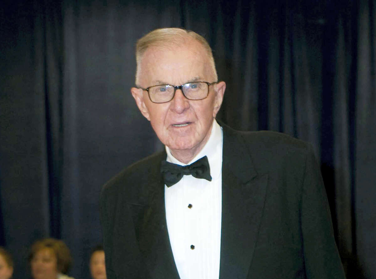 """John McLaughlin arrives at the White House Correspondents' Association Dinner in Washington in 2012. McLaughlin, the conservative political commentator and host of the namesake long-running television show that pioneered hollering-heads discussions of Washington politics, died Tuesday, Aug. 16, 2016, according to the Facebook page for """"The McLaughlin Group."""" He was 89."""