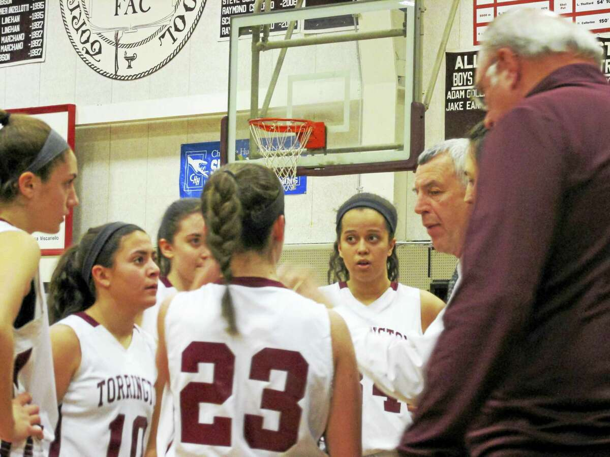 Coach Mike Fritch (second from right) looks for more intensity in a Torrington girls basketball win over Crosby Tuesday night at Torrington High School.