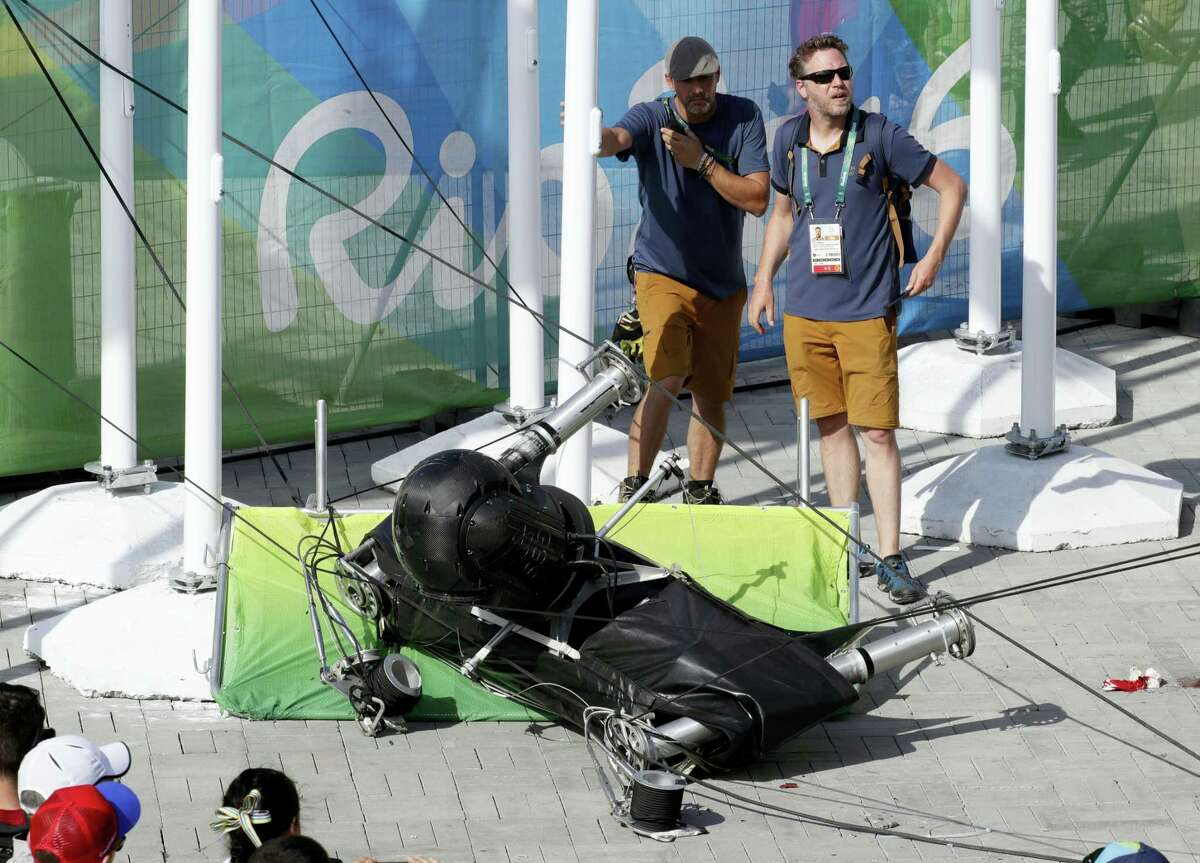 An overhead camera that fell from wires suspending it over Olympic Park lays on the ground in Rio de Janeiro, Brazil, on Monday.