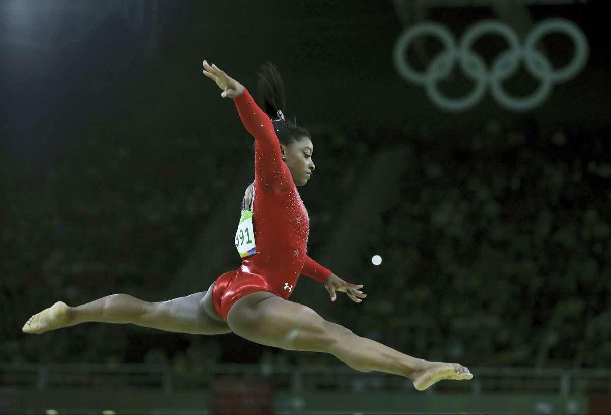 Simone Biles performs on the balance beam in Rio de Janeiro on Monday.