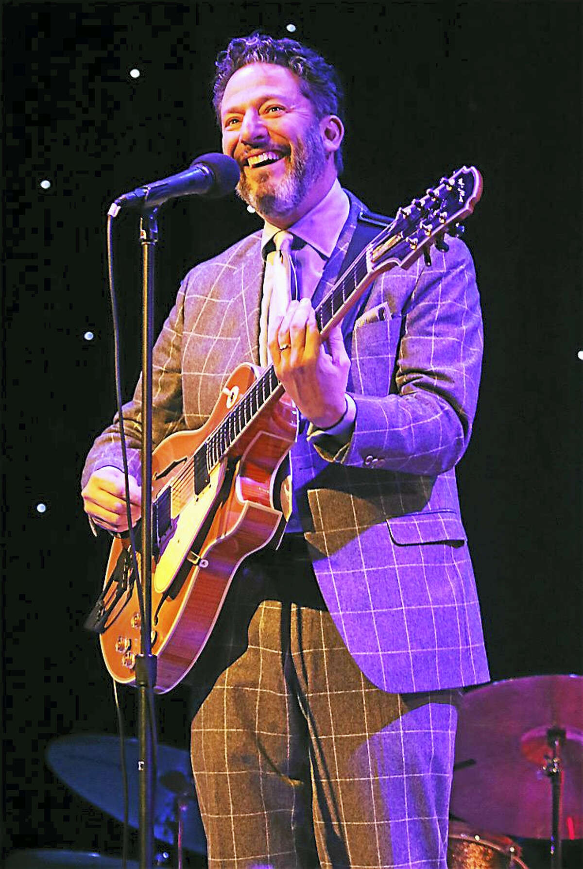 Photo by John AtashianJazz guitarist, vocalist, songwriter and bandleader John Pizzarelli performs during his concert at Infinity Music Hall in Hartford on Dec. 10. During his career During his 33-year music career, John has recorded over 20 solo albums and has appeared on more than 40 albums of other recording artists, including Paul McCartney, James Taylor and many others. To learn more about musician John Pizzarelli go to www.johnpizzarelli.com