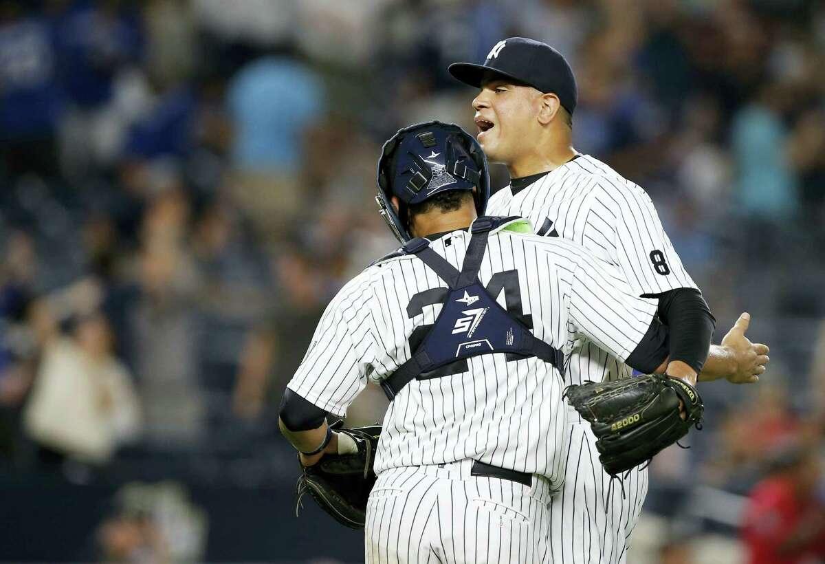 Yankees catcher Gary Sanchez (24) celebrates with Dellin Betances after Monday's win.