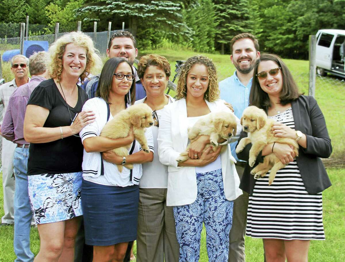 Photos by Erica KasperFrom left, Lu Picard co-founder of ECAD with representatives of state officials and ECAD puppies and future Service Dogs including Jacqueline Fonseca-Ramos, Eunice Ramirez, Alice Diaz, Mary Yatrousis; and back row, from left, Nick Savaria and Josh Philips.