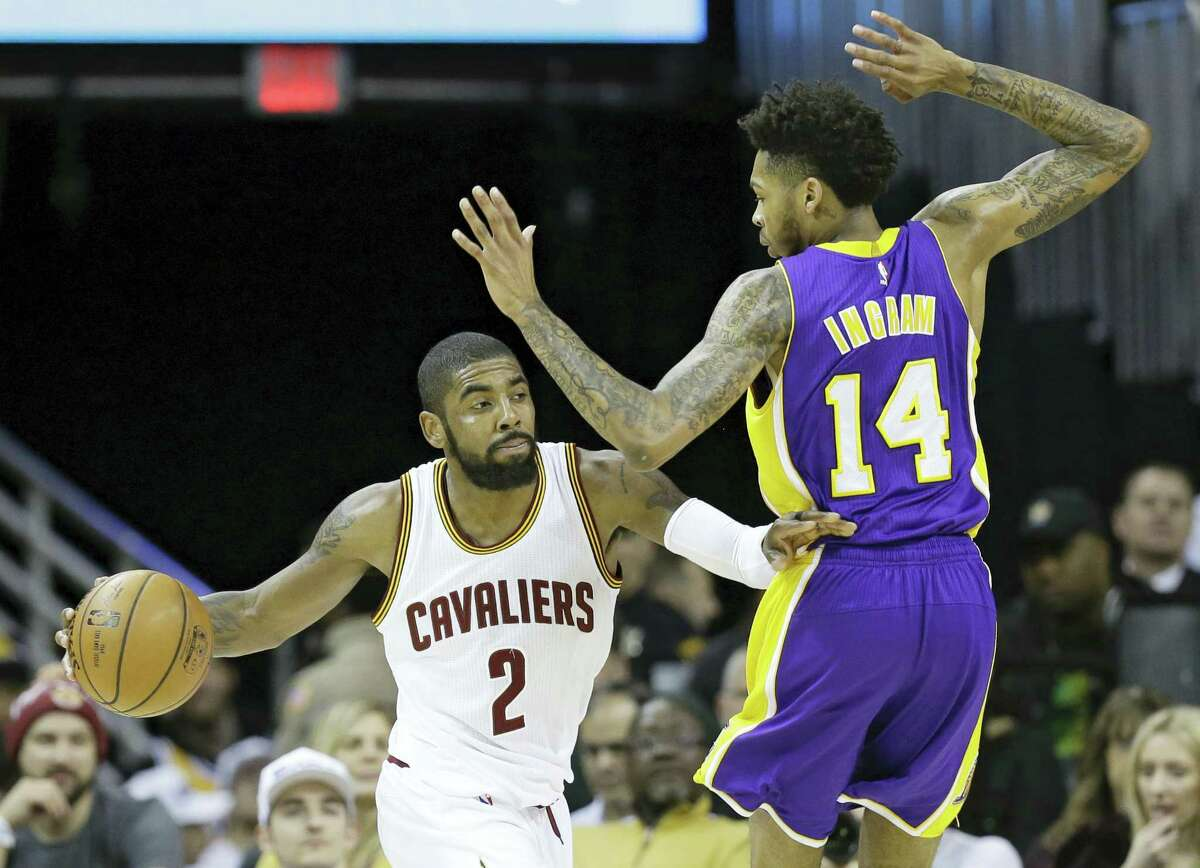 Cleveland Cavaliers' Kyrie Irving (2) drives past Los Angeles Lakers' Brandon Ingram (14) in the second half of an NBA basketball game Saturday, Dec. 17, 2016 in Cleveland.