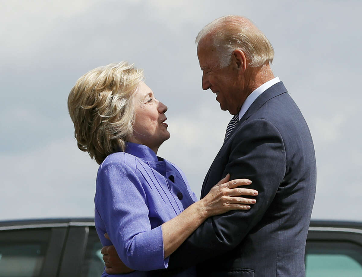 Democratic presidential candidate Hillary Clinton greets Vice President Joe Biden on the tarmac at Wilkes-Barre/Scranton International Airport in Avoca, Pa. on Aug. 15, 2016, before traveling together to a campaign event in Scranton, Pa.