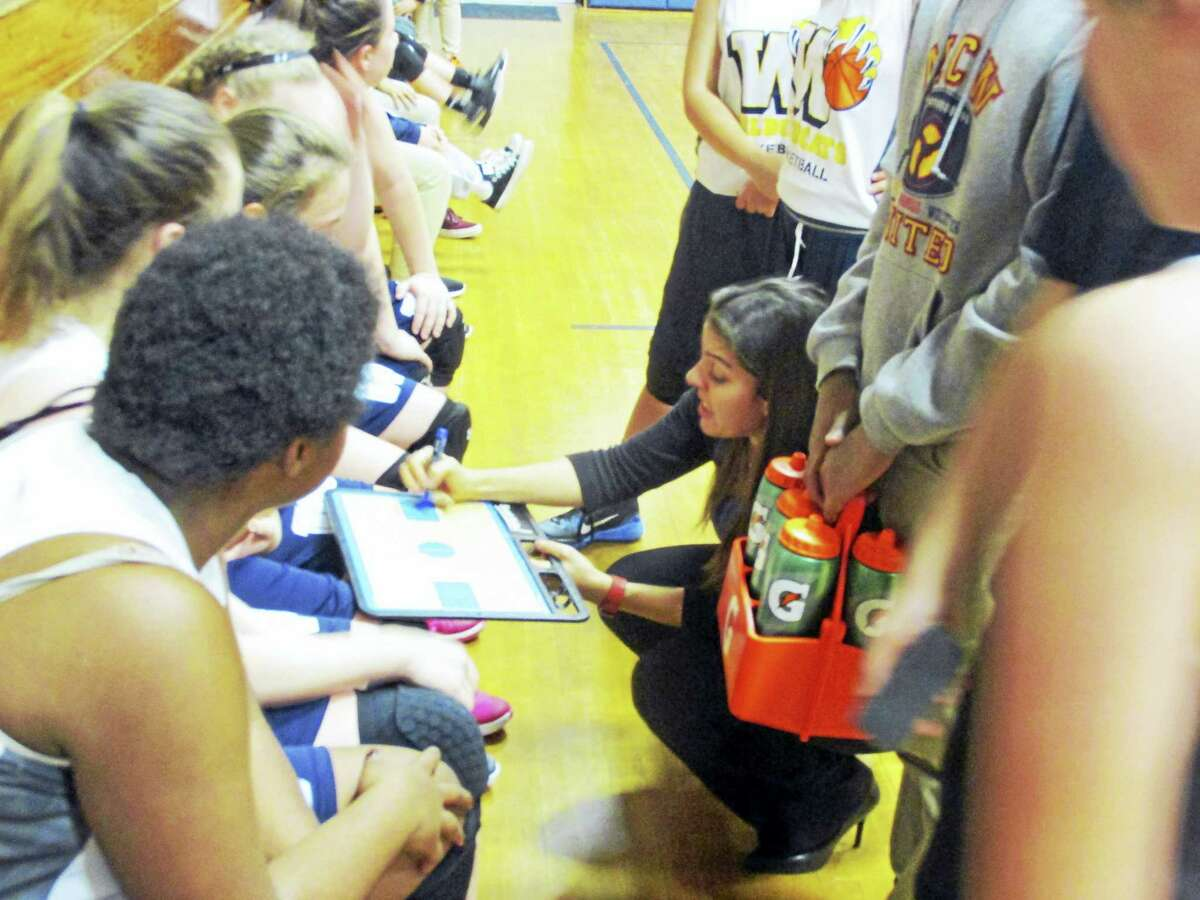 Wolcott Tech Coach Jenn Stango charts the course for her team's first win of the season Monday night against Vinal Tech.