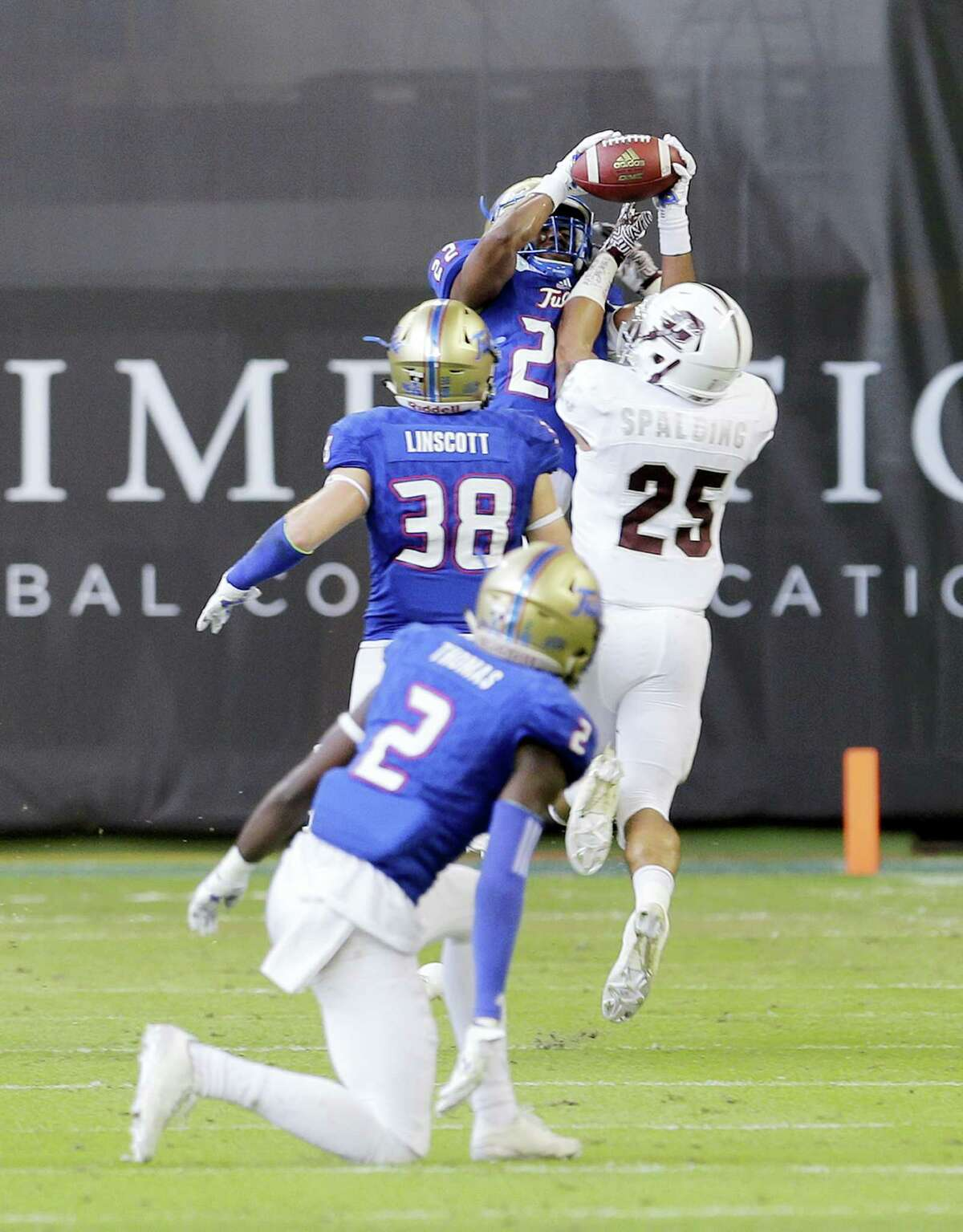Tulsa safety Jeremy Brady (22) intercepts a pass intended for Central Michigan running back Devon Spalding (25) in the first half of the Miami Beach Bowl. Tulsa beat Central Michigan 55-10.