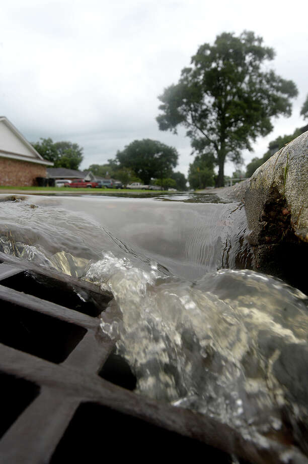 Water pours into a storm drain on 31st Street in Nederland  Photo: Kim Brent / BEN