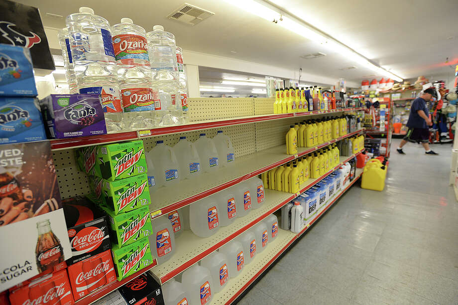 Supplies, including bottled water and gas cans, were still on the shelves at the gas station in Sabine Pass the day after Hurricane Harvey made land, battering the Gulf communities surrounding Corpus Christi. Heavier rains and wind are expected to impact the Southeast Texas region within the coming days, increasing the risk for severe flooding. Photo taken Saturday, August 26, 2017 Kim Brent/The Enterprise Photo: Kim Brent / BEN