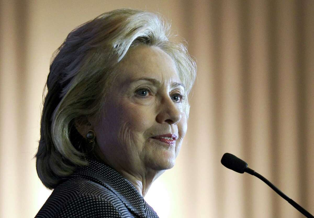 In this Dec. 6, 2013 photo, former Secretary of State Hillary Rodham Clinton speaks on Capitol Hill in Washington.