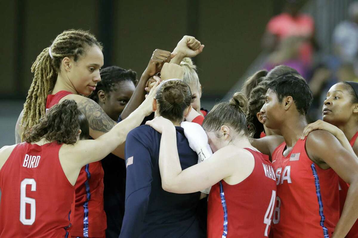 The United States women's basketball team huddles at mid court after beating China on Saturday.