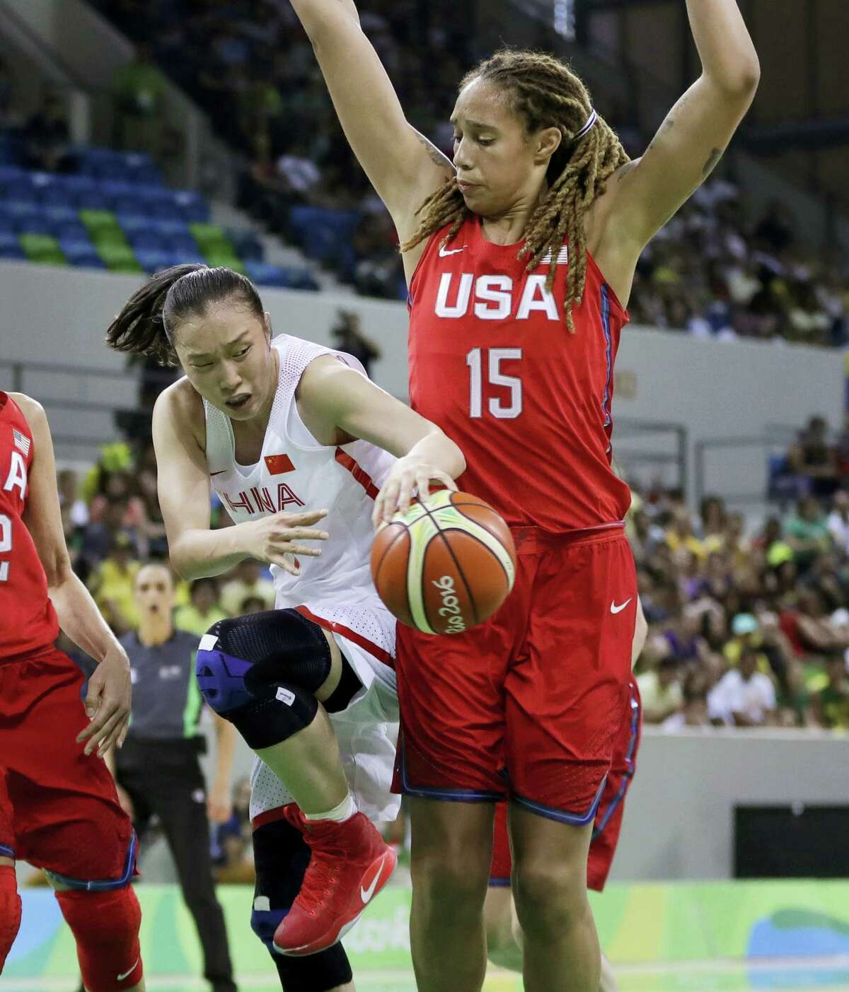 China forward Ting Shao passes the ball around United States center Brittney Griner during the second half.
