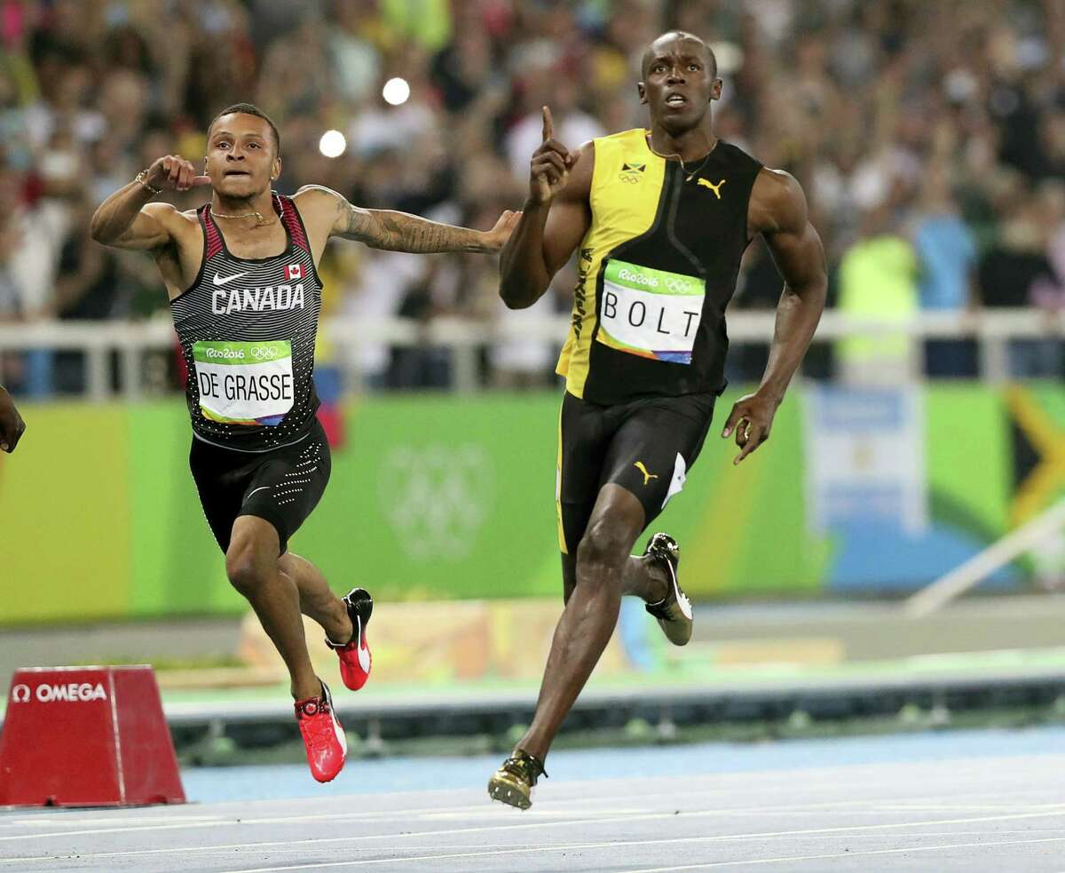 Jamaica's Usain Bolt celebrates as he crosses the line to win gold in the men's 100-meter final at the Olympic stadium in Rio de Janeiro on Sunday.