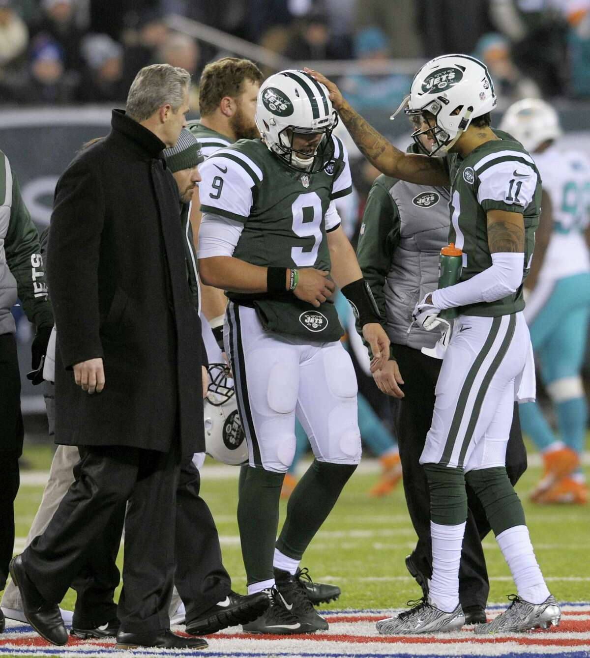 Jets quarterback Bryce Petty (9) walks off the field after getting injured during Saturday's game against the Dolphins.