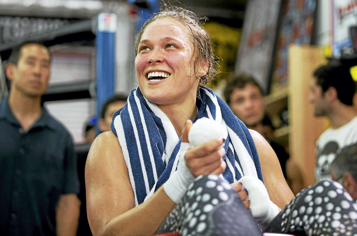 This file photo shows mixed martial arts fighter Ronda Rousey, who also won a bronze medal in judo in 2008.