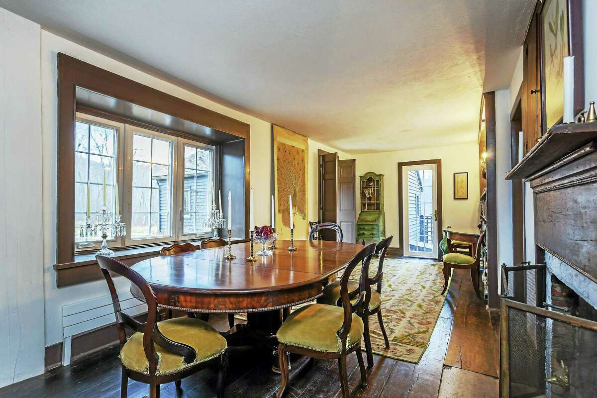 The dining room has plentiful space for a large table and seating.
