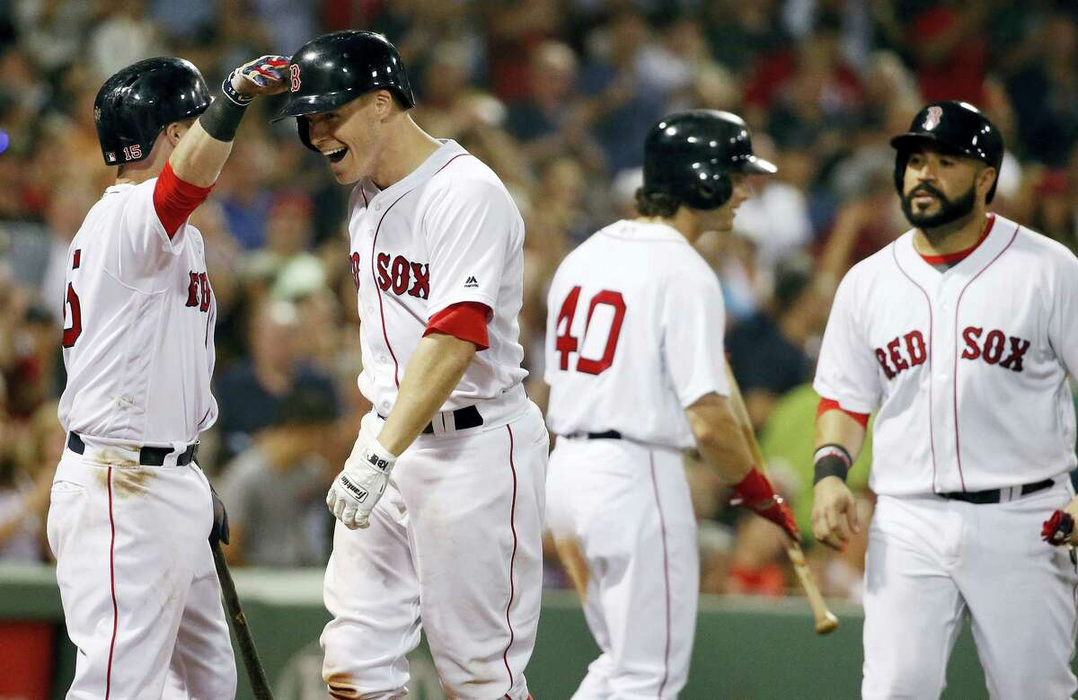 Brock Holt, second from left, celebrates his two-run home run in the sixth inning on Saturday.