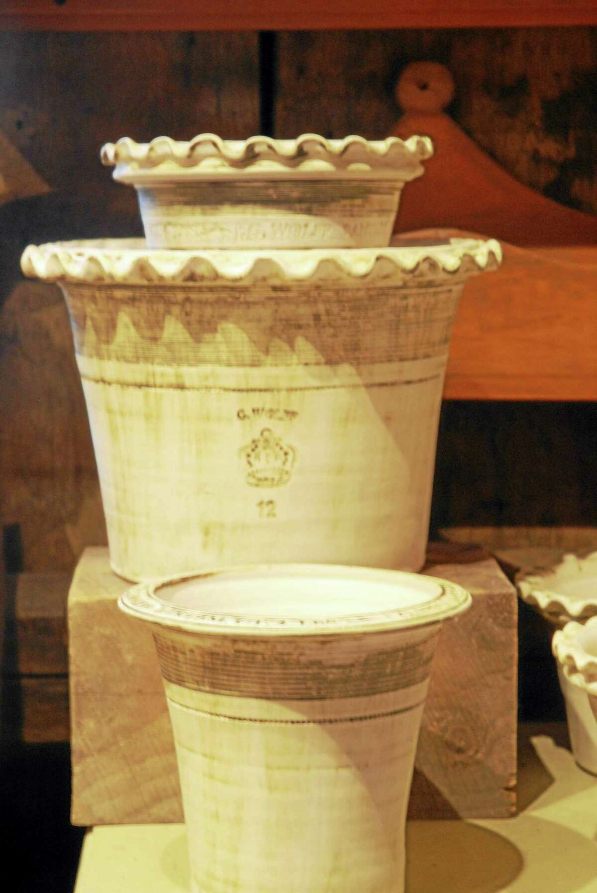 Traditionally, potters stamped their name into their work.