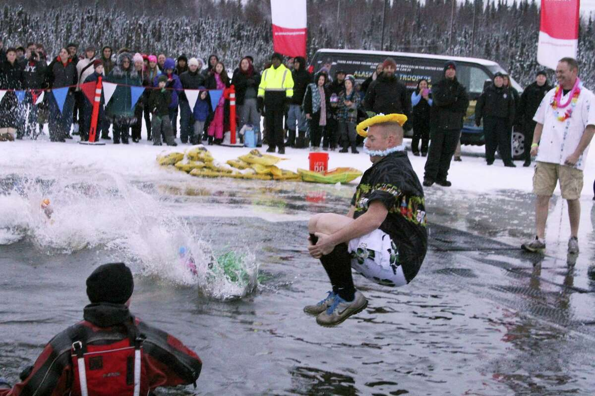 More than a thousand Alaskans took part in a polar plunge fundraiser at Goose Lake on Dec. 17, 2016 in Anchorage, Alaska. The plunge was a benefit for Special Olympics Alaska, and has raised more than $2 million for the organization in the eight years it has been held.