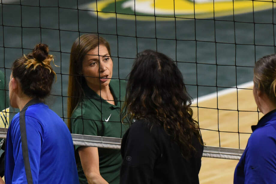 Midland College volleyball head coach Tammie Jimenez shakes hands with Western Texas College players and staff after a win Aug. 26, 2017, at Chaparral Center. James Durbin/Reporter-Telegram