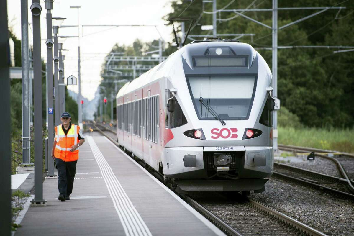 The train stands at the station after a man attacked other passengers aboard the train at Salez, Switzerland, on Saturday, Aug. 13, 2016. Police in Switzerland say a Swiss man set a fire and stabbed people on a train in the country's northeast, wounding six people some seriously, and injuring himself. (Gian Ehrenzeller / Keystone via AP)