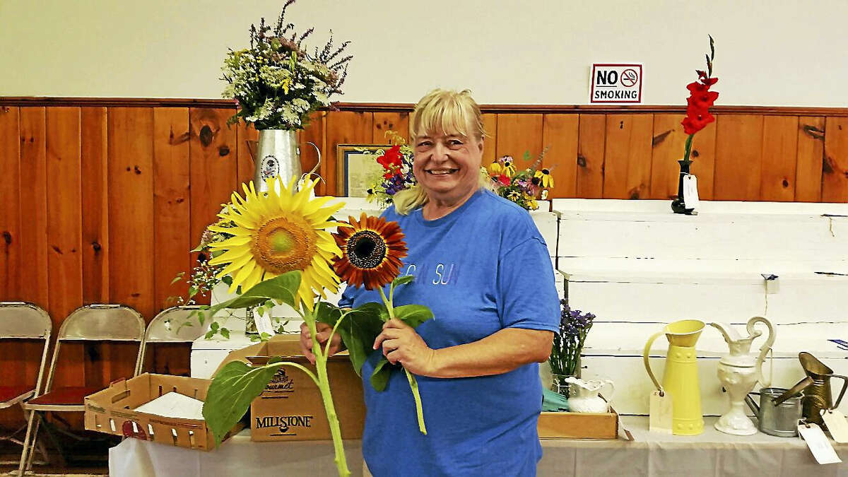 Carol Buice of Winchester exhibited her first-prize-winning sunflowers at the 65th annual Winchester Grange Fair and Flea Market on Saturday.