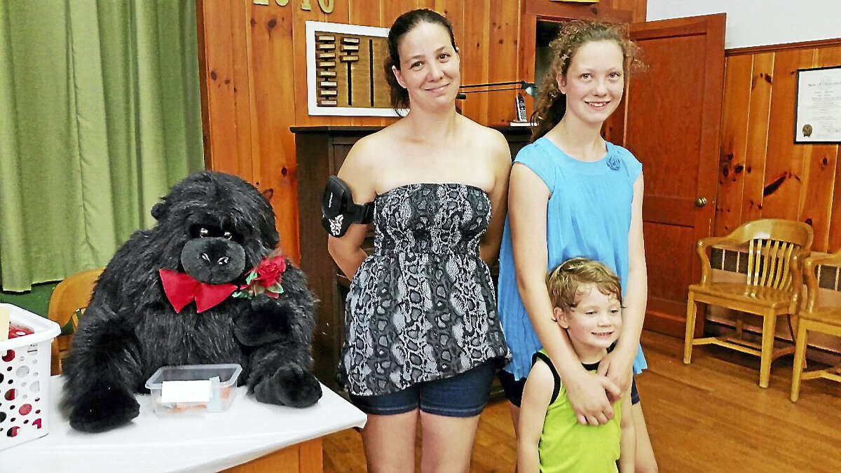 Kate Fitzgerald of Torrington (along with her daughter Sierra, 12, and son Parker, 3) participated in a raffle of a gorilla stuffed animal and other prizes at the 65th annual Winchester Grange Fair and Flea Market on Saturday.
