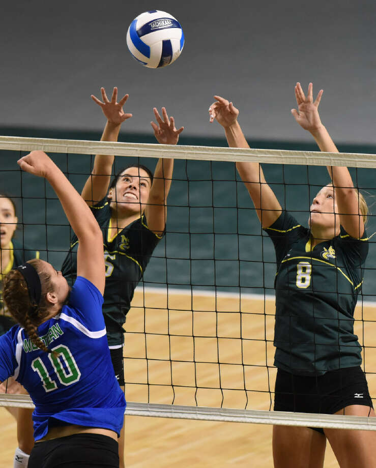 Midland College's Breann Schreiber (8) and Luisa Nieto (15) block against Western Texas College's Cali Watson (10) on Aug. 26, 2017, at Chaparral Center. James Durbin/Reporter-Telegram