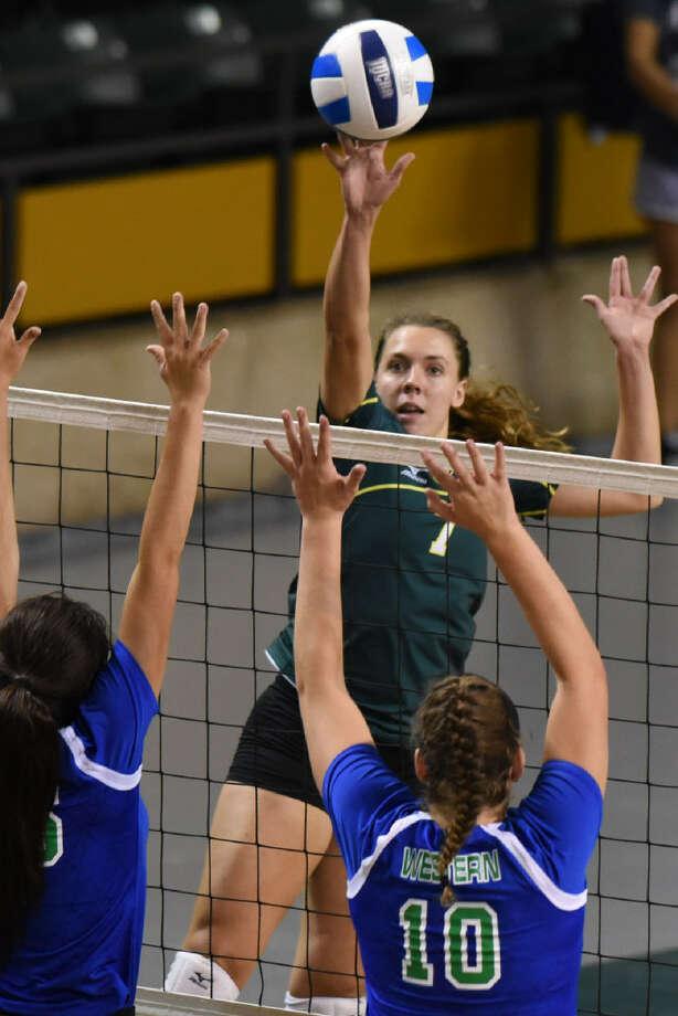 Midland College's Kristen Johnson (7) hits against Western Texas College on Aug. 26, 2017, at Chaparral Center. James Durbin/Reporter-Telegram